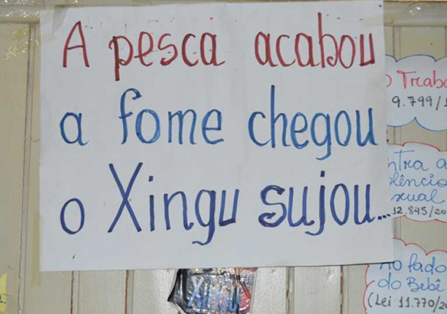 A placard in the office of Xingu Vivo, an environmental advocacy NGO. It reads: ?The fishing ended, hunger arrived, the Xingu got dirty.? Photo by Zoe Sullivan